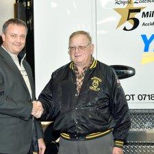 Darren Hawkins congratulates Roy Lincoln on 5 million miles