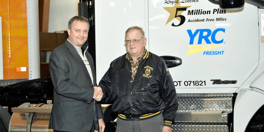 Darren Hawkins congratulates Roy Lincoln on 5 million miles